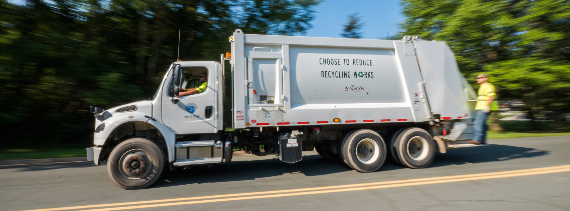 city trash truck in motion
