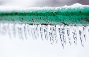 a frozen pipe with icicles