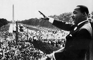 martin luther king, jr. waves to a crowd on the national mall in washington, d.c.