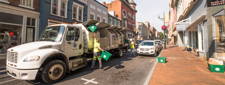 city workers loading recycling truck
