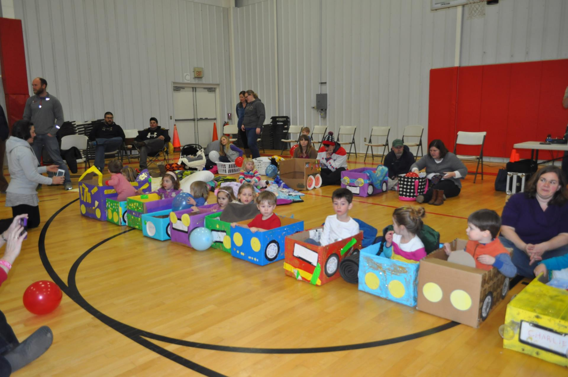 Children sit in their cardboard cars during the Gypsy Hill Drive-in Movie event